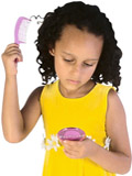 mixed-race child combing hair