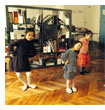 The children are passionately learning how to dance with teacher Hoang Yen
